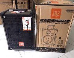 =82 Loa bluetooth JBZ 106 vỏ gỗ tặng 1 micro ko dây